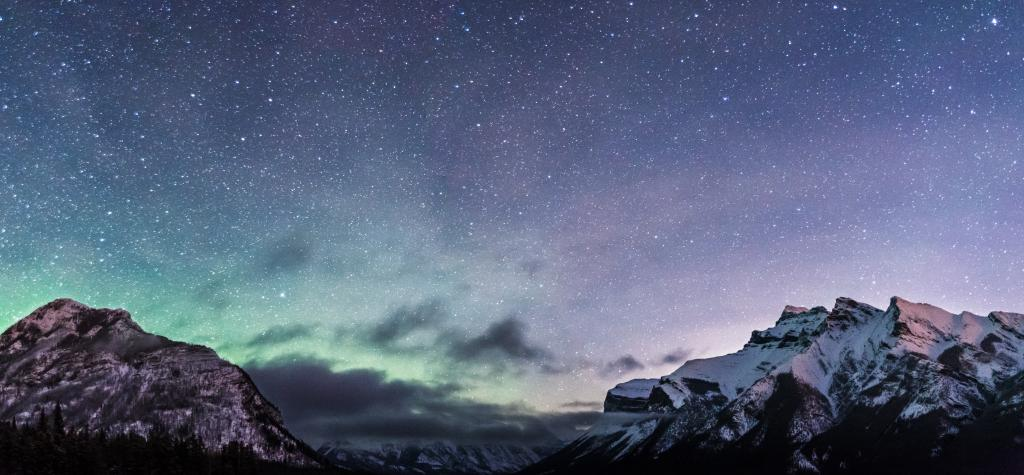 Countless stars and a hint of an aurora borealis illuminate the night sky above the Canadian Rockies. It is a cold -20C in the early morning of Christmas day but worth every bit as I gaze in awe at this magical Christmas present.