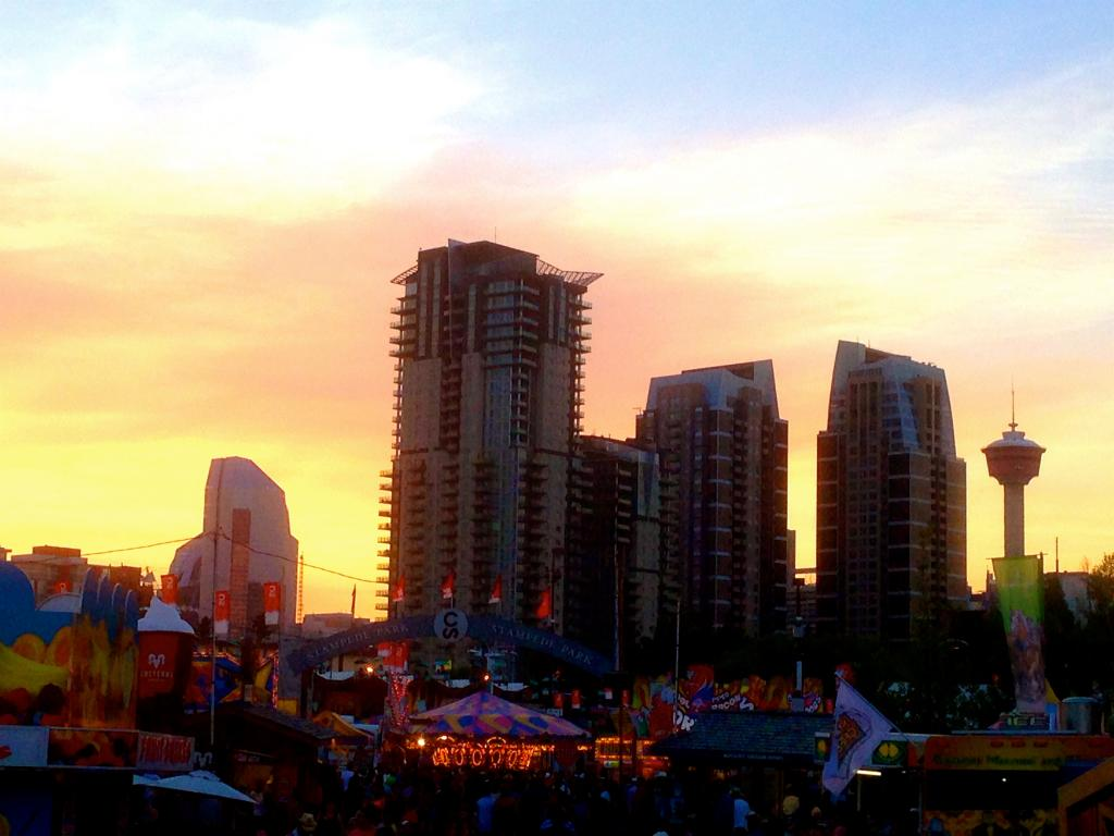 A warm July evening is accompanied by a sunset over the Calgary Stampede's grounds
