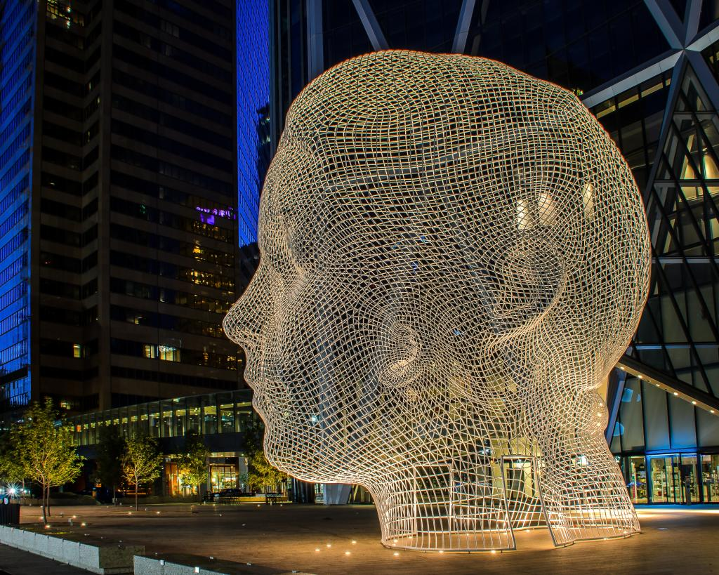 I captured this image of Calgary's Wonderland Sculpture in front to the Bow Building on a beautiful summer evening at twilight time.