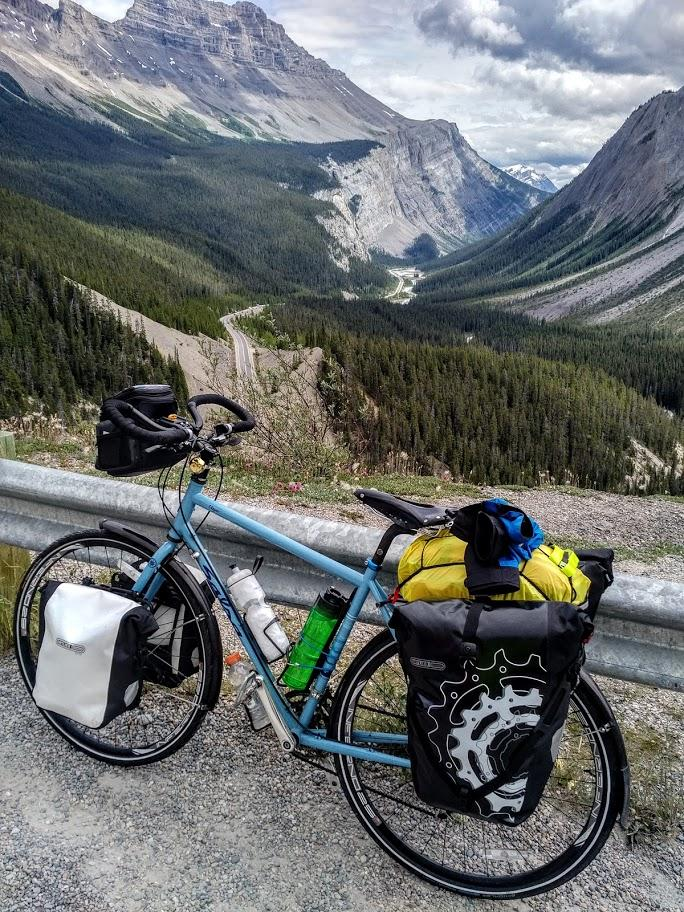 Cycling the Icefields Parkway. Spectacular mountain scenery all the way. A breathtaking ride.