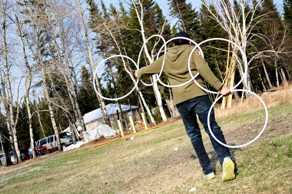 A youth participant at the 2016 Regional Youth Leadership Conference in Waswanipi learns about the hoop dance as his love for dance takes flight. Indigenous youth remain the fastest growing population in Canada as many youth continue their search for identity in the traditions of song and dance.