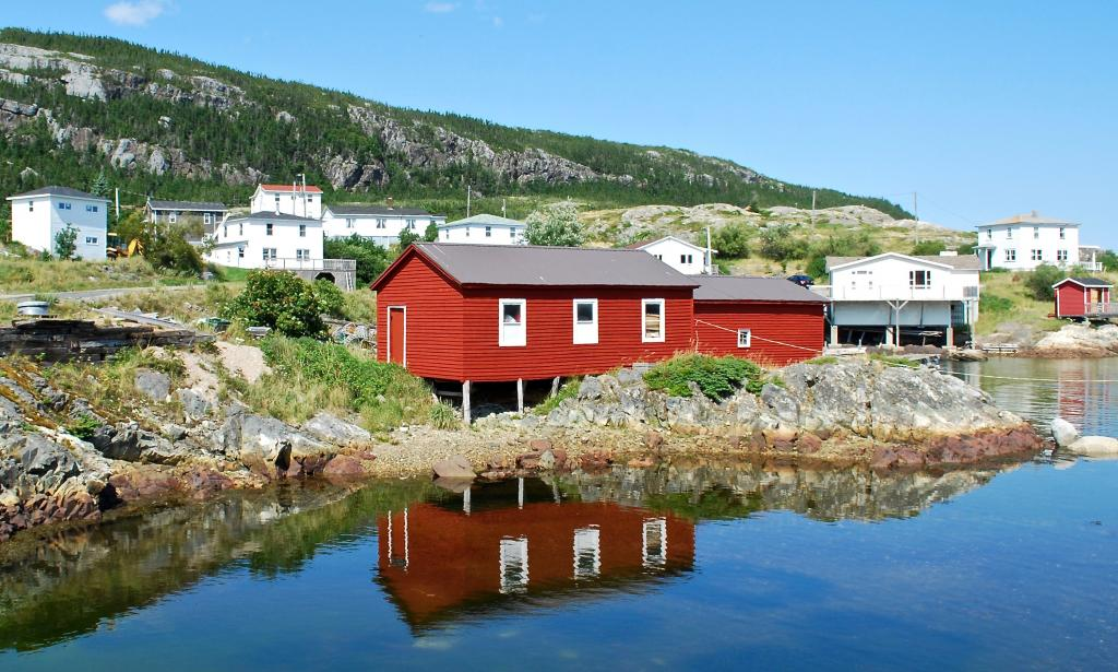 A bright and bold building on the shore of Salvage, Newfoundland. Salvage, and other nearby communities along the Eastport Peninsula, have historically provided opportunities for fishing, sealing, boat building and other livelihoods.