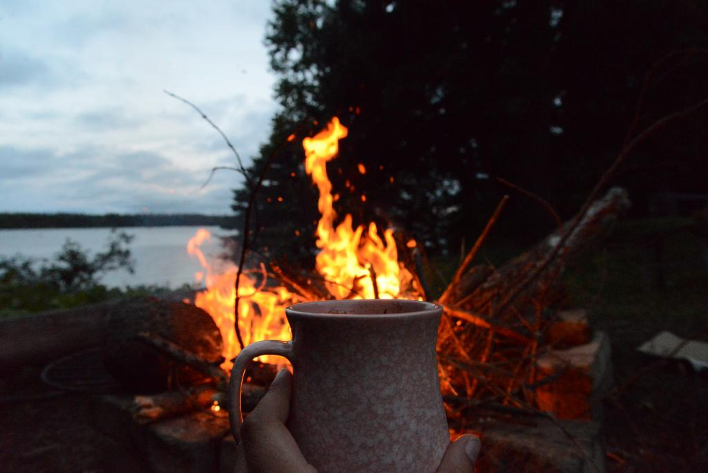 Enjoying the Canadian Wild: fireside chai, and soft pastel skies.