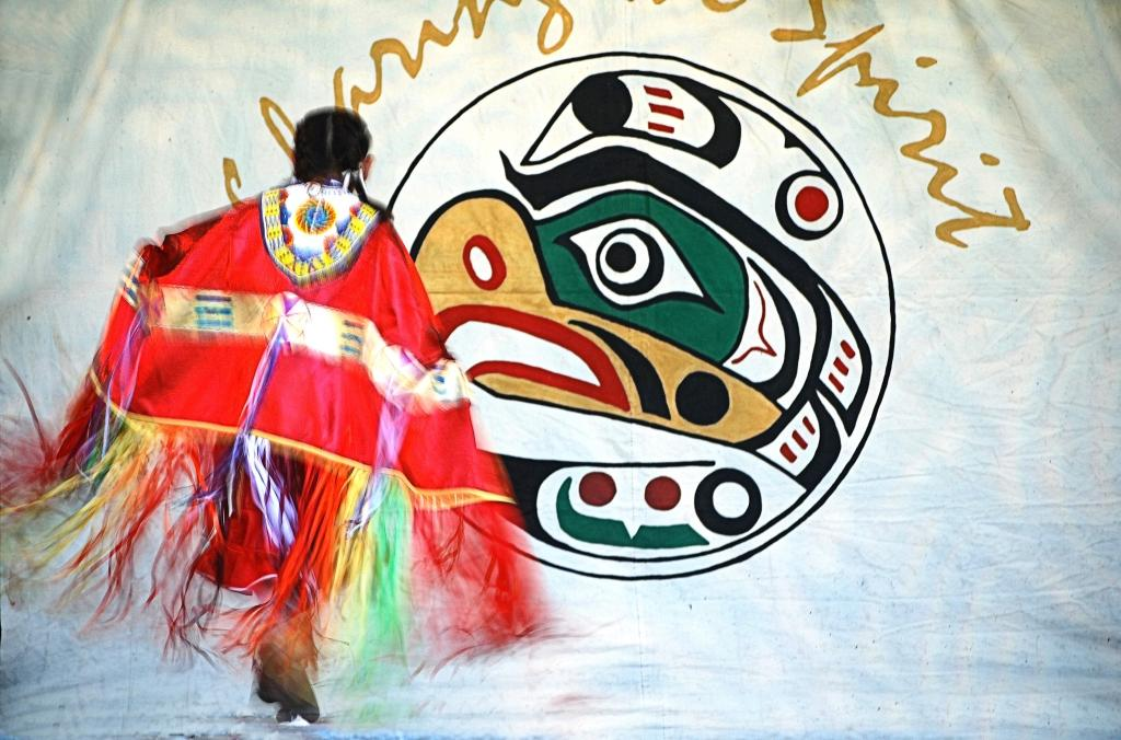 A young woman dances the Ladies Fancy Dance at National Aboriginal Days near Victoria, BC