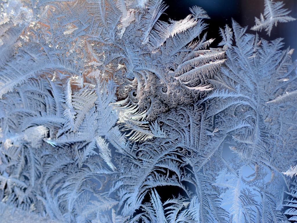 This macro photo is of frost deposits on the exterior pane of a double paned sliding aluminum window over a kitchen sink in Calgary.
