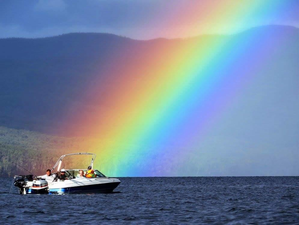 This photo was taken on Babine Lake British Columbia in August 2016. While out fishing a small rain storm passed over and immediately after, this gorgeous, bright rainbow appeared right on the water. The boat pictured belongs to my uncle, I was able to snap a picture just as he passed by the rainbow. I have no experience in photography and this photo is not edited, I am quite pleased with how it turned out!