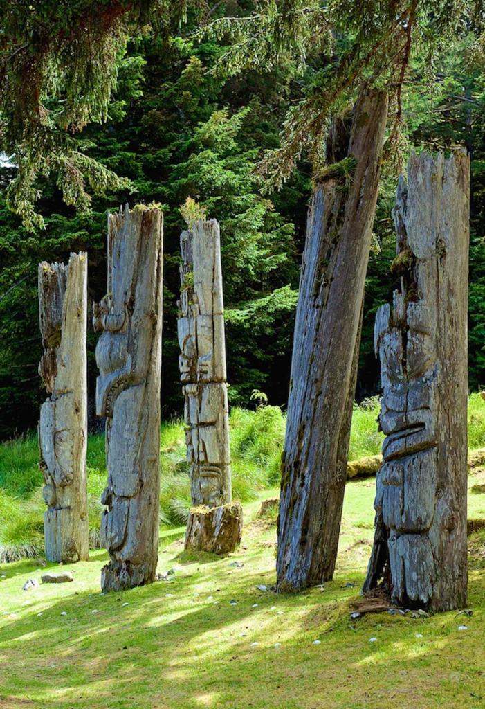 This summer I was able to spend a week in Haida Gwaii, and this photograph of the totems at K'uuna (Skedans) caught the light at the right time.