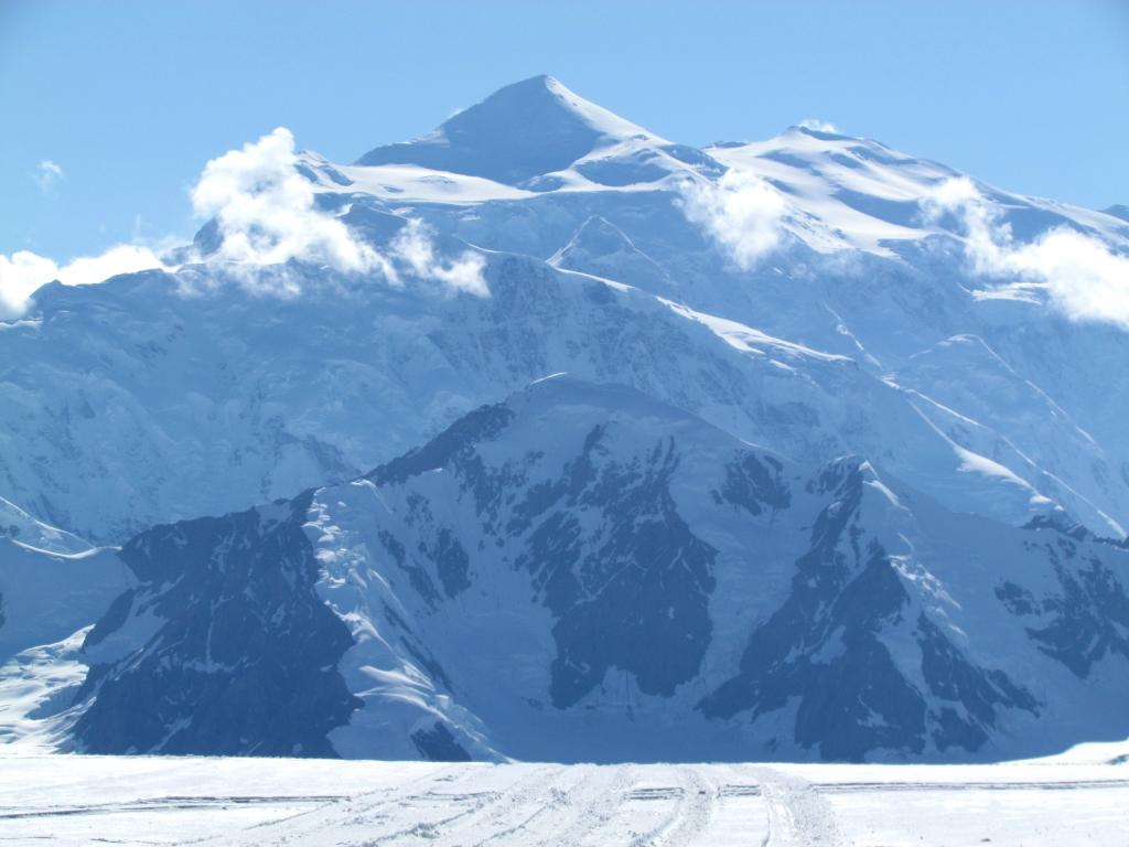 Mt. Logan rises another 11,000 feet above the ice field where the airplane landed on skies.  Photo was taken Aug. 1, 2015.