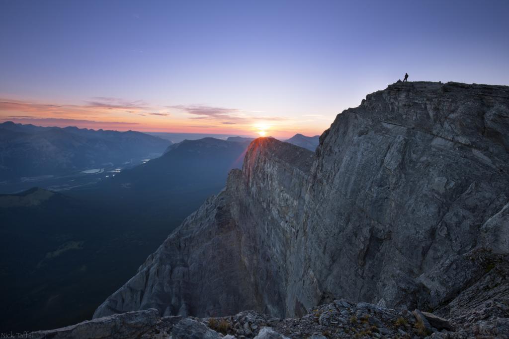 I took my father in law on an epic adventure to his first ever summit. We started hiking before 3 am in hopes to witness a sunrise from the top. This is shot of Shaun atop Windtower in Kananaskis Alberta.