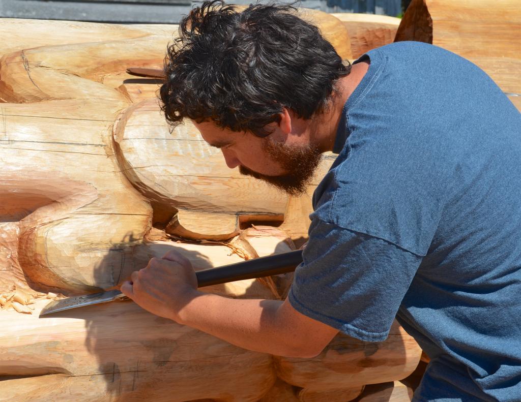 Jaalen Edenshaw carving the Reconciliation Pole, Old Masset, Haida Gwaii