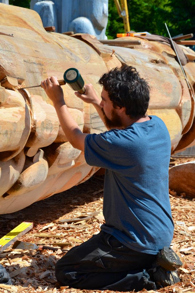 Jaalen Edenshaw carving the Reconciliation Pole in Old Masset, Haida Gwaii