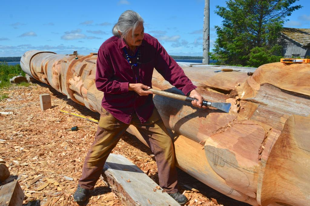 Jim Hart carving Reconciliation Pole in Old Masset, Haida Gwaii