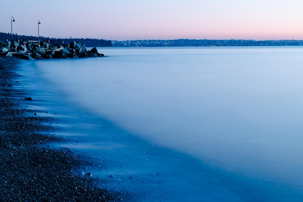 Dundarave Beach in West Vancouver on a winter's evening just after the sun had set below the Pacific Ocean.  The far shores of Kitsilano and UBC in the background.