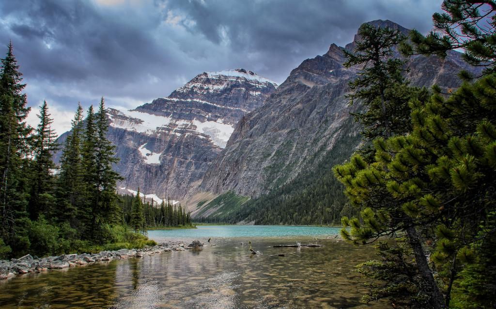 Global warming poses a threat to the world's glaciers, including Mount Edith Cavell's Angel Glacier.  I captured this image of the glacial blue waters of Lake Edith Cavell on a beautiful August summer day in 2016.  As a country, we all hope future generations will continue to enjoy Canada's natural beauty.
