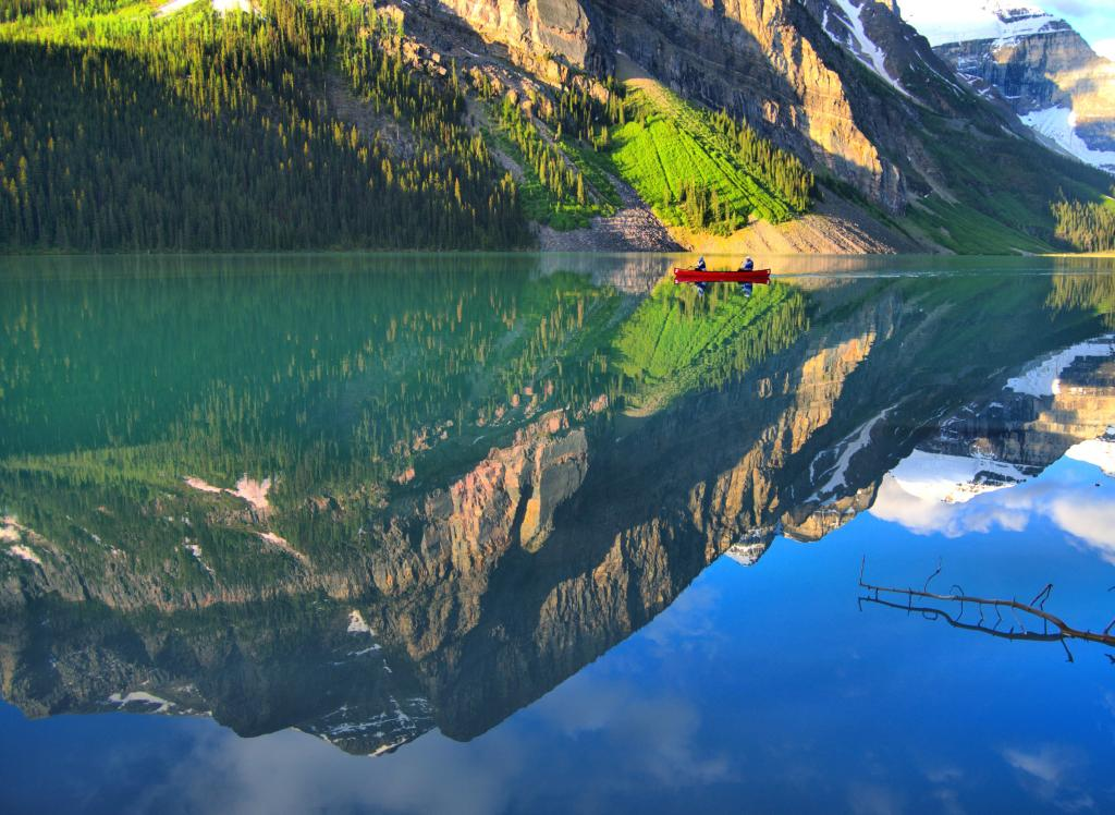 The glassy waters of Lake Louise mirror the surrounding mountains