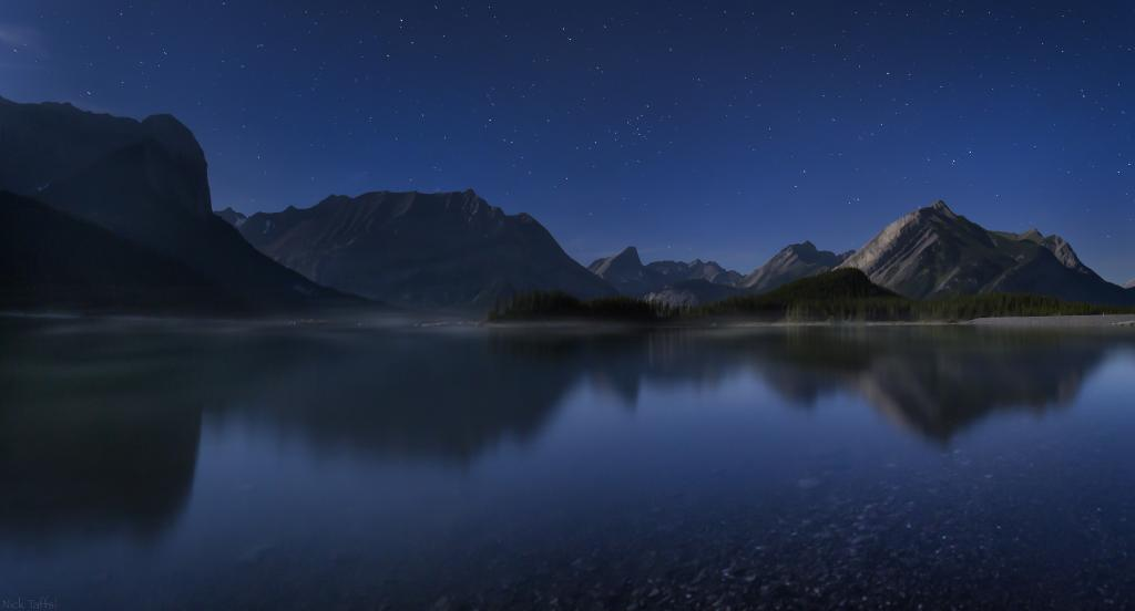 I arrived on location at about 11 pm on a weeknight after an hour and a half drive through the mountains on my first attempt to capture a meteor shower. I only had a couple of meteors that night, but I was able to swing a cool panorama of upper Kananaskis lake.