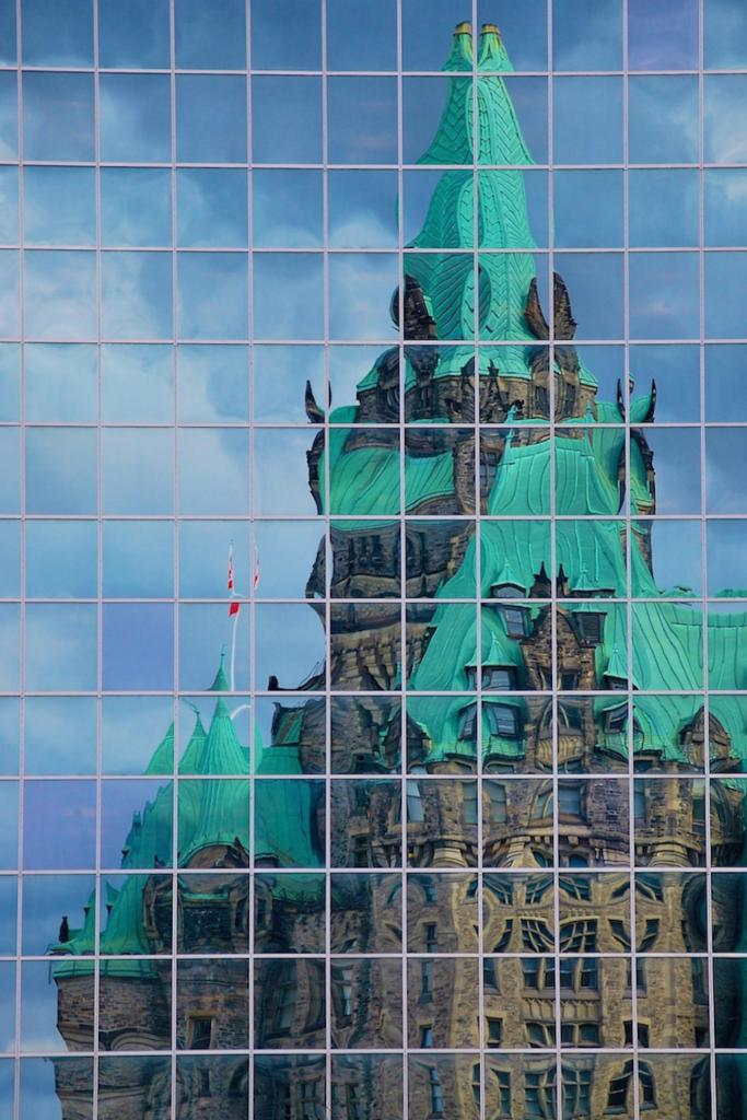 While walking past the Parliament Buildings in Ottawa, I noticed this reflection of the renovations taking place.