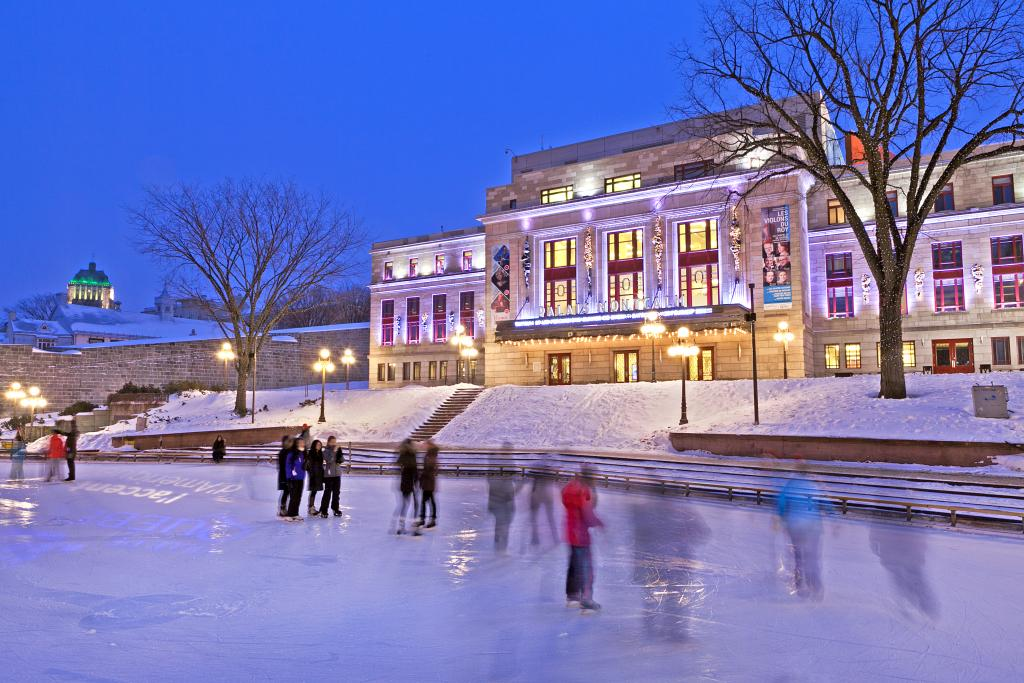 """People of different cultures skating at the Palais Montcalm SHOUTS """"Canadian""""."""