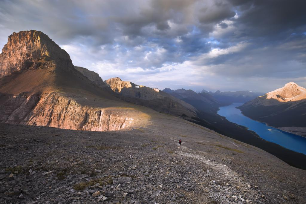 A lone hiker takes the long hike back down after summitting the Windtower in Kananaskis, near Canmore Alberta.
