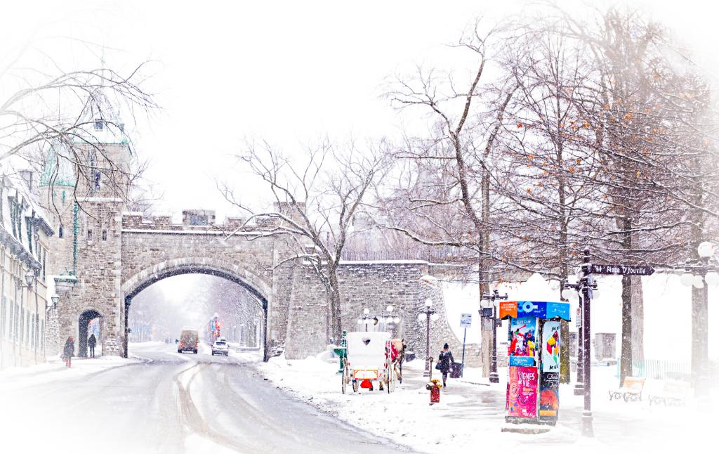 Image captured Jan 2016. Although this gate was built in 1880, the Ramparts of Quebec City, a National Historic Site of Canada, are the only remaining fortified city walls in North America north of Mexico, dating to 1694. The Quebec Winter Carnival is a festival held in Quebec City on and off since 1894.