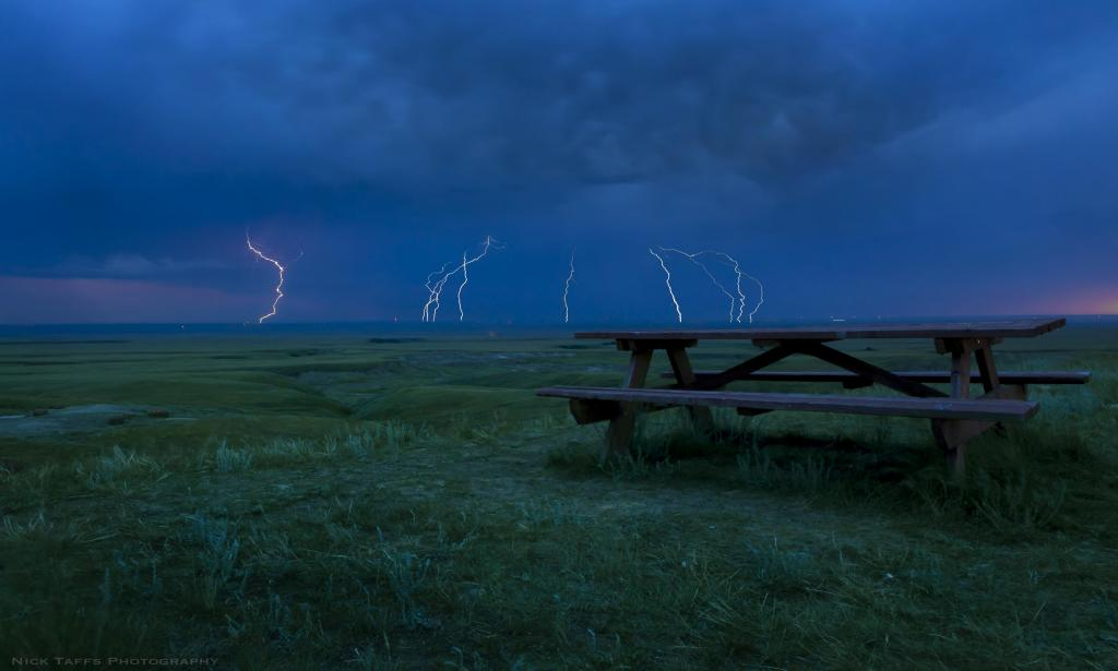 A thunderstorm rolls through red rock coulee in southern Alberta. This is a long exposure image to show the force of the storm and how little shelter there is in this barren landscape.