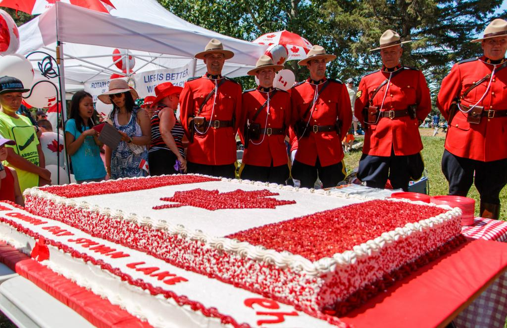 Canada Day in Sylvan Lake, Alberta in 2016. Every year on Canada Day in Sylvan Lake there is a giant cake at the pier where members of the RCMP, the mayor, and council members cut and give out pieces to everyone that is there.