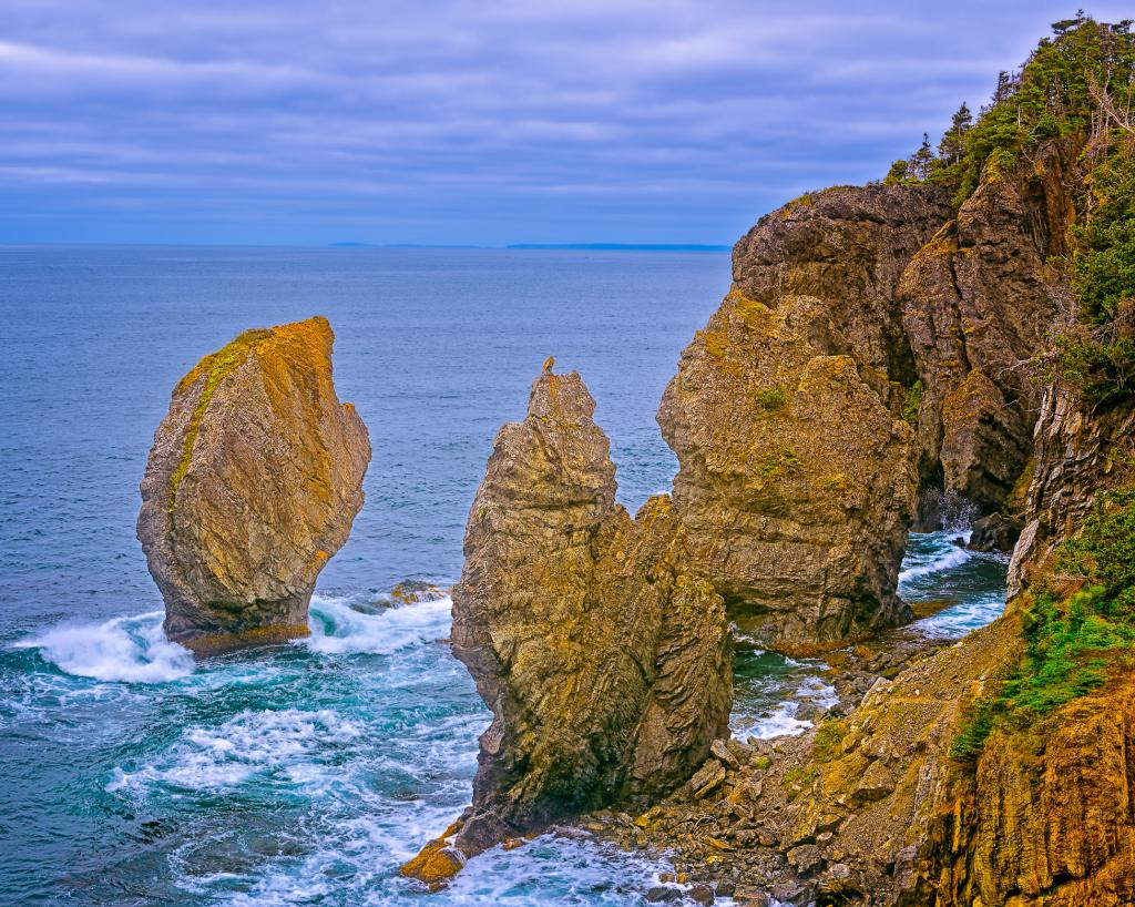 Captured Aug 2016. Sea Stacks are formed of sedimentary rock and shaped by the Atlantic winds, waves and Newfoundland's perennial freeze and thaw cycles. These stacks appeared after the last Ice Age which ended about 10,000 years ago.