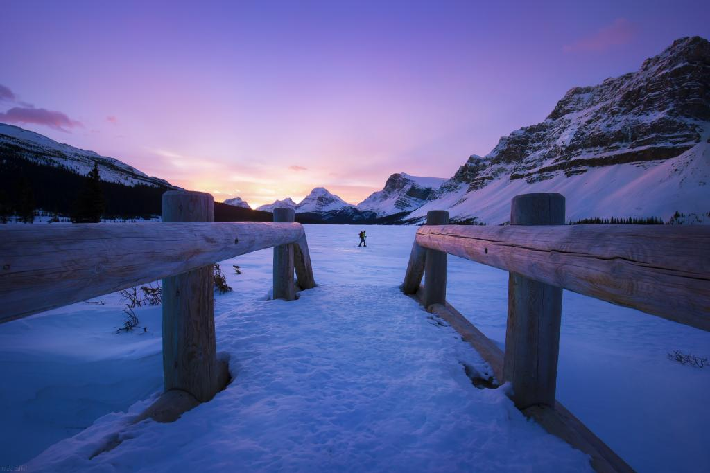 Timing is everything in photography. Waking up at 4:00 am, I set out for a sunrise shot of Bow Lake in Banff, Alberta. I only had a couple of minutes to wade through chest high snow from the parking are to the lake before the sun was up. Just by chance once I was fully set up a skier was crossing the lake to head off into the backcountry at the perfect spot, at the perfect time for me to quickly snap this image.